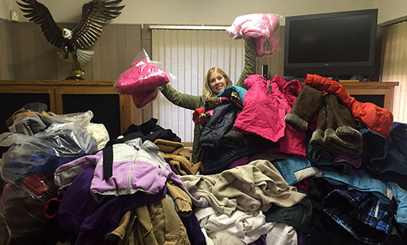 Image of Michelle sorting through the many coats we received at last year's coat drive!
