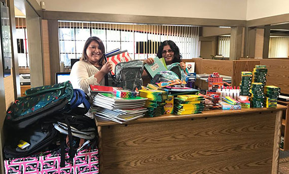 Image of Rachael and Karla organizing our backpack drive donations
